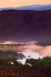 Early morning fog rises above the San Juan River near Bluff, Utah.