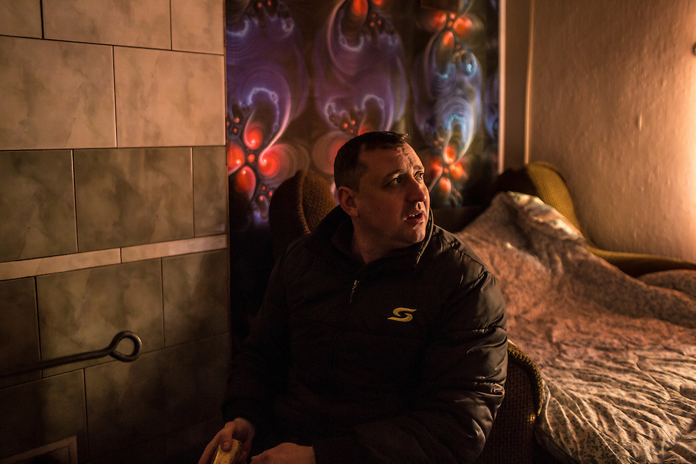 MARIINKA, UKRAINE - FEBRUARY 20, 2016:  Pastor Sergei Kosyak of the Christian Help Center of the Church of the Transfiguration at home in Mariinka, Ukraine. The Donetsk suburb has been the scene of some of the heaviest fighting recently between Ukrainian forces and pro-Russian rebels. CREDIT: Brendan Hoffman for The New York Times