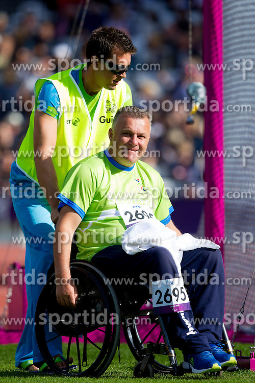 Coach Sebastjan Grosek and Joze Flere of Slovenia during Men's Discus Throw F51/52/53 athletics competition during Day 9 of the Summer Paralympic Games London 2012 on September 6, 2012, in  Olympics stadium, London, Great Britain. (Photo by Vid Ponikvar / Sportida.com)