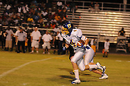 Oxford High's William Elliott (4) runs vs. Charleston in Charleston, Miss. on Friday, August 26, 2011. Oxford won.