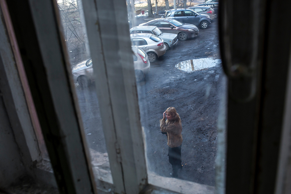 Inessa Rozova, Alexander Panin's mother, stands outside Panin's grandmother's apartment, where he was mostly raised, on Tuesday, February 25, 2014 in Tver, Russia. Panin, a Russian citizen who was arrested in the Dominican Republic in June 2013, is set to be charged by federal authorities in the US with being part of a gang which robbed bank accounts via the Internet. Photo by Brendan Hoffman, Freelance