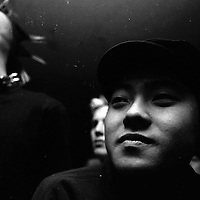 """BEIJING, HAIDIAN DISTRICT,CHINA-JULY 3,1999:.Shen Yue of Anarchy boys watches his friends perform at a punk show in the Scream bar, July 3, 1999, in China.. In the spring of 1998, a handful of youngsters teamed up to unofficially rebel against conformist Chinese life. They shaved their heads, and founded bands with names like """"Brain Failure"""" and """"Anarchy Boys"""".  To some like Punker Xiao Rong, this lifestyle was an extension of the life he'd begun as a school dropout at age sixteen.-Although the majority of the punks came from well-off families, they preferred to live in self-imposed poverty. .The Scream Bar and its surrounding dusty alleyways in the student district became the center of youthful rebellion until it was closed . The punks bands have moved on to other bars in Beijing, some got contracts with foreign record companies and even toured Europe, Japan and the US.."""