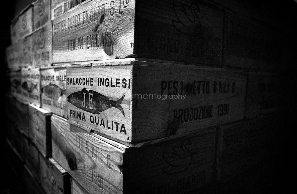 Wooden cases of Salacche Inglesi (English sardines) ready to be exported to Italy where they will be sold.