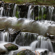 Water cascades from Fern Spring, a natural spring in the main valley of Yosemite National Park, California.