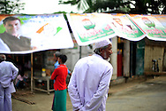 A man walks under a Congress party campaign banner near a polling station during the second phase of voting in parliamentary elections April 23, 2009 in the Muslim dominated town of Mukalmua in the state of Assam, India.  Congress party leaders Rahul Gandhi and Kamal Nath, the commerce minister, and key government allies face Indian voters today in the second round of polling in a five-stage general election.