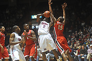 "Ole MIss forward Reginald Buckner (2) is defended by Georgia's Donte' Williams (15) at the C.M. ""Tad"" Smith Coliseum in Oxford, Miss. on Saturday, January 15, 2011. Georgia won 98-76.  (AP Photo/Oxford Eagle, Bruce Newman)"