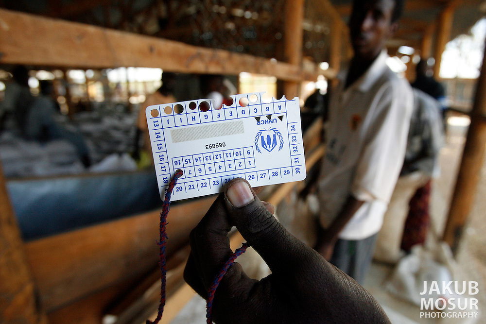 September 14, 2006 - Somali refugee, Abdi Nasir Moktar holds up his food ration card at a food distribution center at the Dagahaley Refugee Camp in Dadaab, Kenya, 50 miles from the Somali border. Somalis are fleeing from recent clashes between Somalia Union of Islamic Courts and Somali warlords. Over 21,000 refugees since January 2006 have arrived in Dadaab which has a growing population of 140,000 refugees, in the North Eastern province of Kenya..(Photo by Jakub Mosur/Polaris)