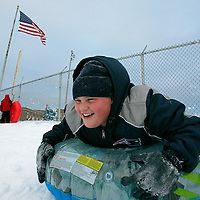 Tommy Spengler, 12, of Rockland Massachusetts, sleds down a hill in his home town on December 27, 2010.  The area was hit by a blizzard which dumped over a foot and a half of snow in other parts of the state and caused coastal flooding.   UPI/Matthew Healey