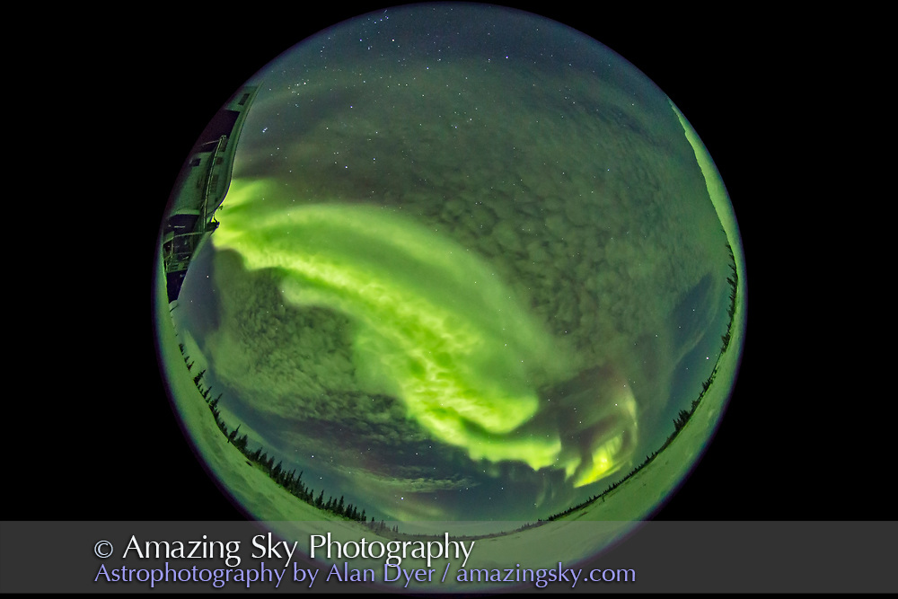 A fish-eye view of an aurora display peaking in activity on January 29, 2017 at the Churchill Northern Studies Centre, Churchill, Manitoba. For a few minutes the aurora formed a bright band rippling across the sky overhead. <br /> <br /> Taken with the Sigma 8mm fish-eye lens at f/3.5 for 5 seconds at ISO 6400 with the Canon 6D. Taken as part of a 1100-frame time-lapse sequence suitable for projection in a planetarium dome.