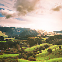 The sun sets over the Akatarawa Valley, North Island, New Zealand.