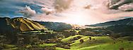 The sun sets over the Akatarawa Valley, North Island, New Zealand.
