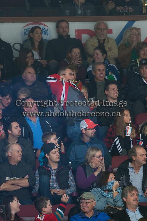 KELOWNA, CANADA - NOVEMBER 22: A fan shows off his Kelowna Rockets t-shirt under his Portland Winterhawks jersey on November 22, 2014 at Prospera Place in Kelowna, British Columbia, Canada.  (Photo by Marissa Baecker/Shoot the Breeze)  *** Local Caption *** fan;