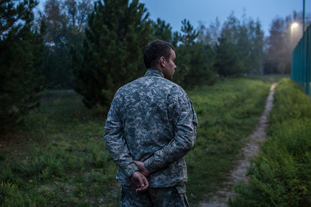 A member of the Azov Battalion, a pro-Ukraine militia, at the group's base on Wednesday, October 15, 2014 in Urzuf, Ukraine. Photo by Brendan Hoffman, Freelance