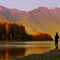 A Woman enjoys the fall colors along the Knik river in Palmer, Alaska