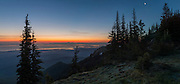 """PANORAMA: Mt. Baker awaits the coming sunrise as a crescent moon hangs over the Strait of Juan de Fuca, Port Townsend and Whidbey Island, and at left, the 5 mile long Dungeness Spit. View from Deer Park in Olympic National Park. (17"""" X 35"""" panorama)"""