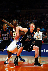 Nov 21, 2008; New York, NY, USA; Duke Blue Devils forward Kyle Singler (12) and Michigan Wolverines forward DeShawn Sims (34) battle for a rebound during the 2K Sports Classic Championship game at Madison Square Garden. Duke won 71-56.