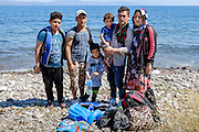 Askhari family who just landed in Mytilene island are from Kunduz city in Afghanistan. They are travelling together with their two children, the husband&rsquo;s brother and the wife&rsquo;s brother. They left Afghanistan because after the leader of the city died, killing started by the Taliban and there was chaos. They traveled for 4 months via Iran and Turkey before they crossed to Greece. Their final destination is Norway because they think they can live there without much worry. <br /> Refugees arriving on beaches near Molyvos village in Lesvos island. Thousands of them come from Turkey, crossing the sea border on inflatable dinghy boats, on a dangerous trip that has claimed many lives. Local people or NGOs expect them and help them in some places but after their arrival, most of them have to walk to the nearest village where they can hope for a places on busses that can take them to the city of Mytilene where they can register and eventually board on a ferry to Athens. Many decide to walk the distance as the busses aren&rsquo;t enough to accommodate the large number of people that arrive daily.