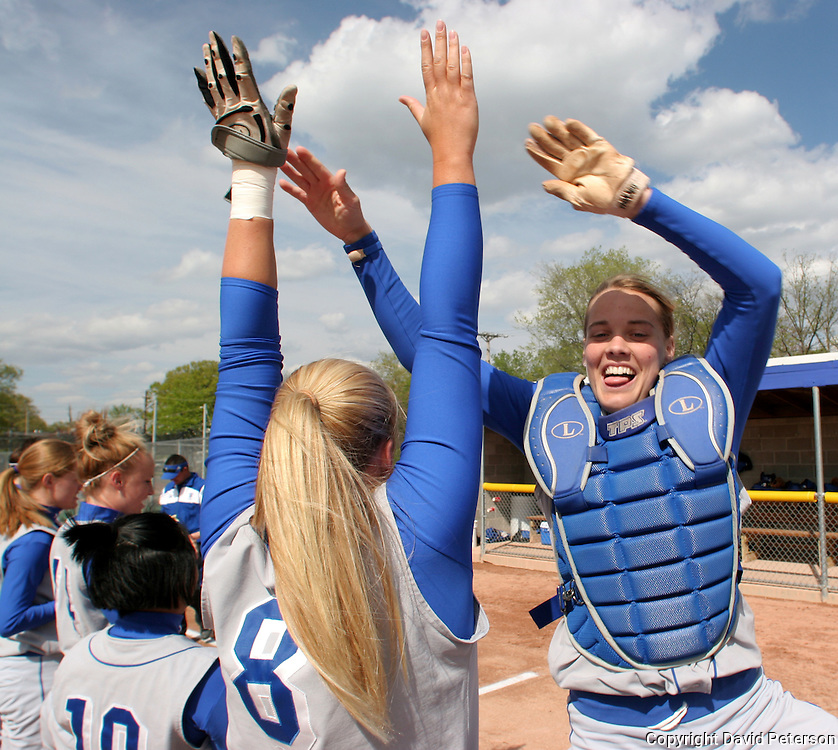 Drake University softball players celebrate a victory after a game in 2005.  Along with a fine athletic department, the private University in Des Moines, Ia., has been lauded for it's outstanding programs in the arts in addition to having one of the best law schools and pharmacy departments in the country.