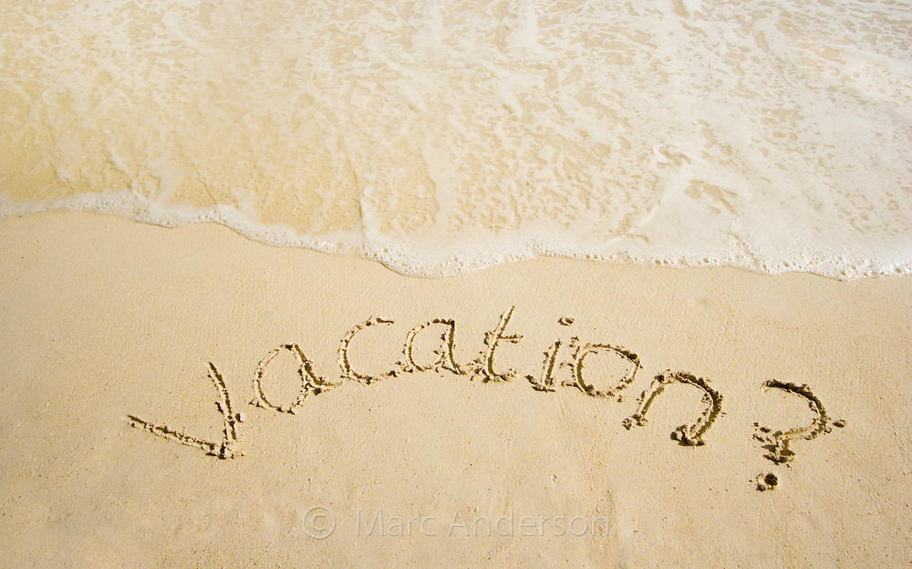 """The word """"VACATION"""" written in sand on a tropical island in the Bacuit Archipelago, Philippines"""