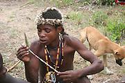 Africa, Tanzania, Lake Eyasi, Hadza men preparing the arrows before a hunting expedition Small tribe of hunter gatherers AKA Hadzabe Tribe