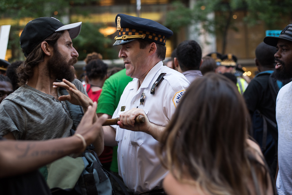 Chicago Police force protesters off Michigan Avenue during a march against ongoing police violence in Chicago on July 9, 2016.