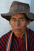 Campesino man selling ponchos in Tarabuco, Chuquisaca, Bolivia