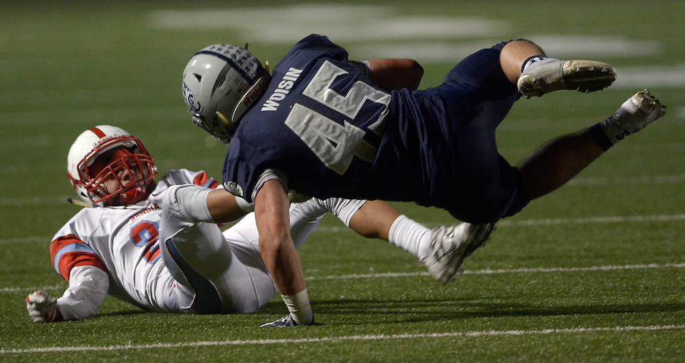 gbs102016r/SPORTS -- Sandia's Nathan Riley, left, upends La Cueva's Josh Woisin, 45, during the game at Wilson Stadium on Thursday, October 20, 2016.(Greg Sorber/Albuquerque Journal)