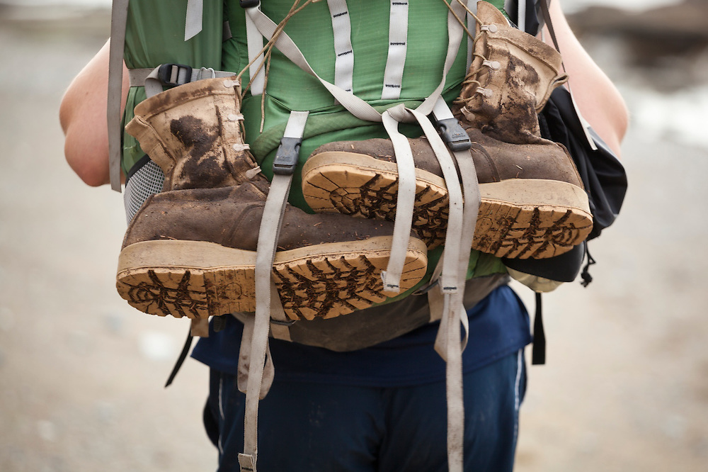 Henry Pedersen carries his boots strapped to his pack, West Coast Trail, British Columbia, Canada.