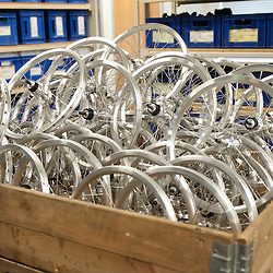 London, UK - 29 January 2013: components of a  folding bike are ready to be assembled in the Brompton Bicycle factory in South West London. The company was founded in 1976 by Andrew Ritchie and is one of only two major frame manufacturers still based in the UK. Today, Bromptons are sold in 42 export markets.