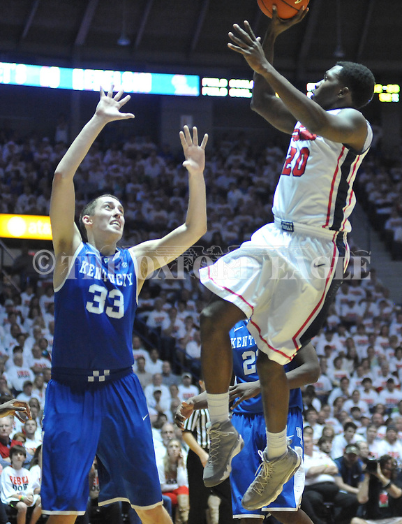 """Mississippi's Nick Williams (20) shoots as Kentucky's Kyle Wiltjer (33) defends at the C.M. """"Tad"""" Smith Coliseum on Tuesday, January 29, 2013. Kentucky won 87-74. (AP Photo/Oxford Eagle, Bruce Newman).."""