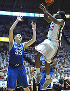 "Mississippi's Nick Williams (20) shoots as Kentucky's Kyle Wiltjer (33) defends at the C.M. ""Tad"" Smith Coliseum on Tuesday, January 29, 2013. Kentucky won 87-74. (AP Photo/Oxford Eagle, Bruce Newman).."
