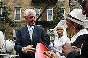 July 24, 2012-New York, NY: Bill Clinton, Former President, USA  attends the official Slyvia Woods Harlem Community memorial and send off through the streets of Harlem. Sylvia Woods was an American restaurateur who co-founded the landmark restaurant Sylvia's in Harlem on Lenox Avenue, New York City with her husband, Herbert Woods, in 1962. (Photo by Terrence Jennings)