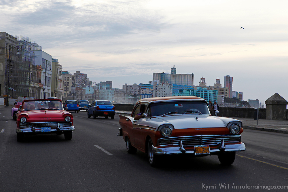 Central America, Cuba, Havana. Classic cars on the malecon, Havana, Cuba.