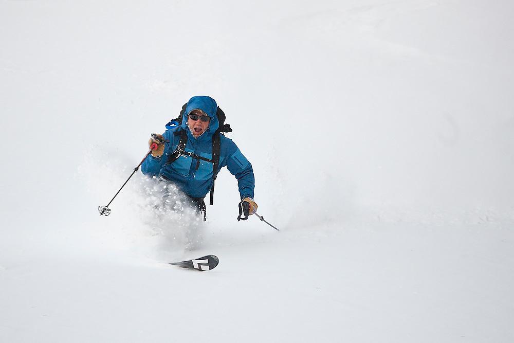Sterling Roop skis deep powder below Hayden Peak, San Juan Mountains, Colorado.