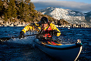Chuck Freedman rolls his kayak on Lake Tahoe near Kings Beach, Calif., January 19, 2011.