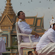 Cambodian Prime Minister Hun Sen looks on as Buddhist monks gather to attend the funeral of former Cambodian King Norodom Sihanouk  Friday Feb. 1, 2013 in Phnom Penh, Cambodia.  The cremation of the former king is set for Feb. 4, 2013.  Sihanouk died last October 15, 2012, in Beijing, China.  He was 89 years old.