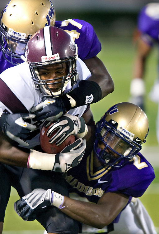 JMU defense pulls down a North Carolina Central player.