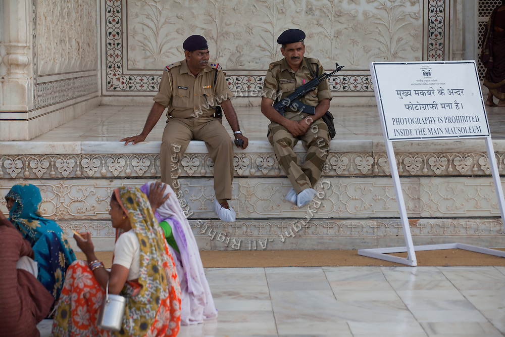 The Indian police is overlooking visitors inside the Taj Mahal complex, in Agra.