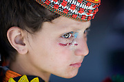 The Kalash claim legendary ancestry of descendents of Alexander the Great's armies left after campaigns in South Asia...Existing in the Hindu Kush Valleys of North West Pakistan, the pagan people believe in one god, Dezau. ..Life is divided into pure (onjesta) and impure (pragata) spheres which impact greatly on daily life...The Kalash festival involves intricate religious ceremonies, feasts and dancing. Men usually stand in the centre beating drums with women dancing and encircling, their arms around each other's waists or shoulders..
