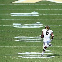 Sep 29, 2012; Orlando, FL, USA; Missouri Tigers running back Marcus Murphy (6) returns a punt for a touchdown against the Central Florida Knights during the third quarter at Bright House Networks Stadium. Missouri defeated Central Florida 21-16.