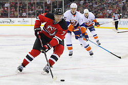 Jan 31, 2013; Newark, NJ, USA; New Jersey Devils defenseman Henrik Tallinder (7) skates with the puck during the second period of their game against the New York Islanders at the Prudential Center.