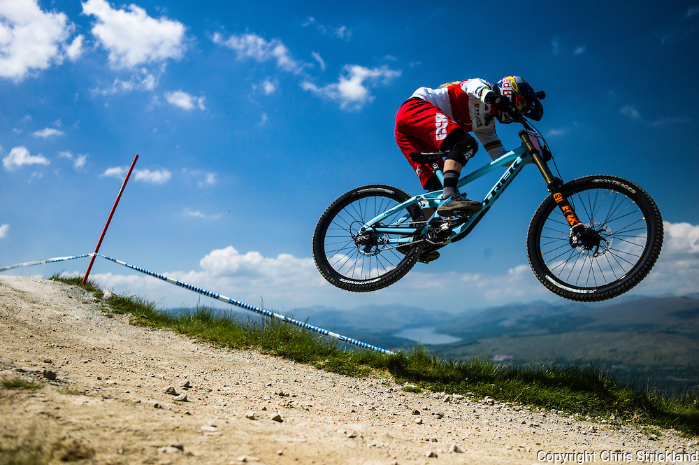 Nevis Range, Fort William, Scotland, UK. 5th June 2016. World champion Rachel Atherton (GBR) jumps through her winning run on the 2.8km course.The worlds leading mountain bikers descend on Fort William for the UCI World Cup on Nevis Range.
