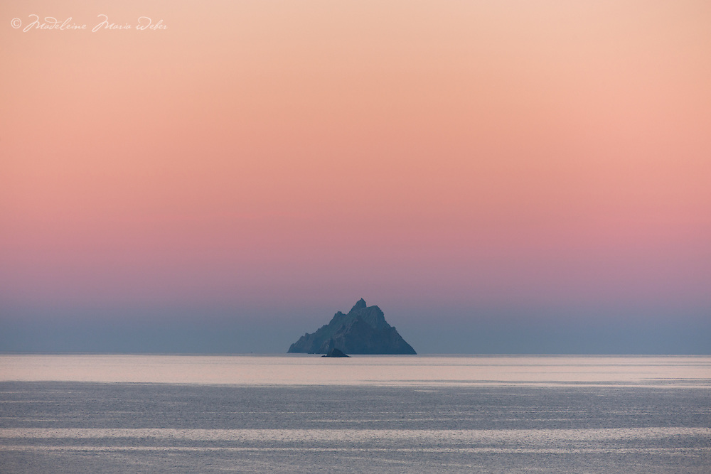 Colourful sunrise over Skellig Michael, Little Skellig and Lemon Rock as seen from St. Finian's Bay Beach, County Kerry, Ireland. <br /> <br /> DEUTSCH: Farbenfroher Sonnenaufgang &uuml;ber Skellig Michael, Little Skellig und Lemon Rock wie man es vom St. Finian's Bay Strand aus sehen kann, County Kerry, Ireland.<br /> <br /> ****** <br /> <br /> Visit &amp; browse through my Photography &amp; Art Gallery, located on the Wild Atlantic Way &amp; Skellig Ring between Waterville and Ballinskelligs (Skellig Coast R567), only 3 minutes from the main Ring of Kerry road.<br /> https://goo.gl/maps/syg6bd3KQtw<br /> <br /> ******<br /> <br /> Contact: 085 7803273 from an Irish mobile phone or +353 85 7803273 from an international mobile phone