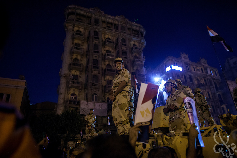 "Egyptian soldiers stand atop an APC during mass demonstrations called for by Gen. Abdel Fattah El Sissi, the head of Egypt's military, in the Tahrir Square area of downtown Cairo Egypt on Friday July 26, 2013. EL Sissi had asked Egyptians to take to the streets on Friday to show the world that he had a mandate to deal with ""violence and terrorism"", ahead of what many believe is a planned crackdown on the Muslim Brotherhood political group."