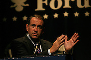 Republican presidential hopeful and former Arkansas Governor Mike Huckabee addresses the Iowans for Tax Relief and Iowa Christian Alliance presidential form in Des Moines, Iowa June 30, 2007.