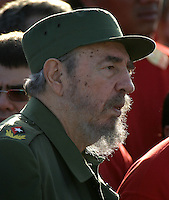 Cuban President Fidel Castro, center, attends to a revolutionary demonstration in the Revolution Plaza on May 1st., 2004 in Havana, Cuba. (Photo/Cristobal Herrera)