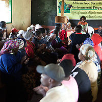 Tea farm workers, local residents, and members of the Nyeri County Citizen's Network pack the Gathambara Tea Collection & Buying Centre to capacity as Cathy Irungu, Candidate for Nyeri County Women's Representative engages with the audience to learn more about issues that are of greatest concern to community residents.