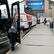 03/21/2014- Stevens Point, Wisc. - India Wilson, A17, walks off the team bus at the NCAA Division III Women's Final Four as the Tufts women's basketball team's opponent, FDU-Florham, exits their bus on Mar. 21, 2014. (Kelvin Ma/Tufts University)