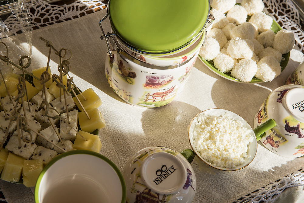 A variety of artisanal snacks including homemade cheese and a stewed milk called toplyonoye at Potapovo Farm on Sunday, August 18, 2013 in Potapovo, Russia.