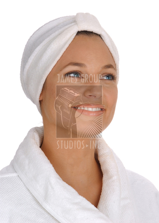 isomorphic view of a beautiful young woman in white terry cloth bathrobe and turban looking clean, fresh and pampered on white background